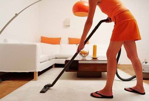 photo_of_woman_vacuuming
